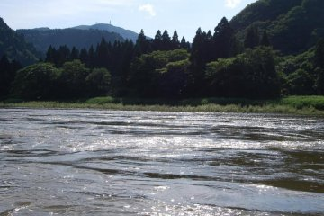 Riding the rapid currents of Mogami River in a small boat could be dangerous.
