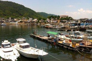 Boats docked on the landing at Tomo-no-ura Bay