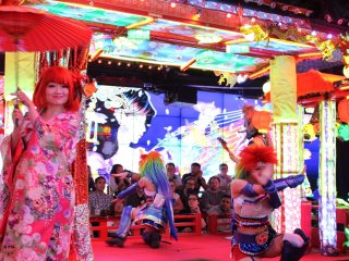 Dancer costumes change throughout the night and range from kimono to street styles