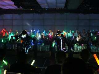 As it goes dark the dancer costumers and glow sticks from the audience really stand out