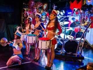 The marching band has about 10-15 members including drummer girls seen here