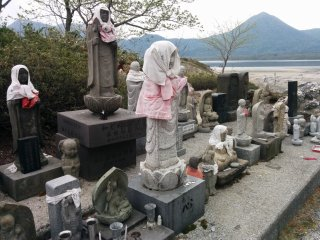 A number of Jizo statues hidden in the back of the grounds