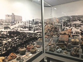 Photo of the destruction and personal items found among the ruins: Hiroshima Peace Memorial Museum
