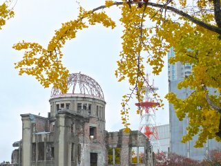 The dome is now flanked by tall modern buildings: Hiroshima's Atomic Bomb Dome