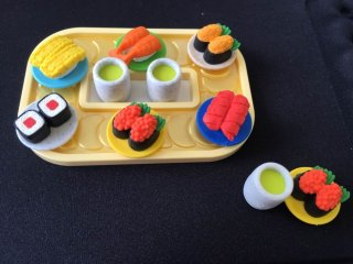 A sushi-go-round style set including 2 cups of green tea and 6 plates of sushi. They are so tiny, but you can still separate the rice and toppings on each one!
