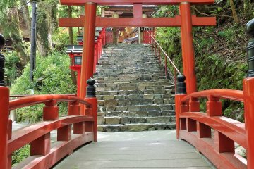 <p>There are two entrances to the main shrine, this back one crosses a tiny stream above which sits a small waterfall.</p>