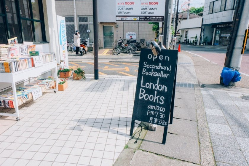 A blackboard signage of London Books in front of the building welcomes you warmly to visit the bookstore
