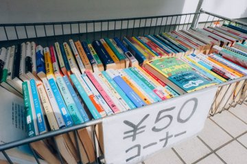<p>The sale section in the front of the store. Most of the books are in Japanese language, so you need to check them out one by one</p>
