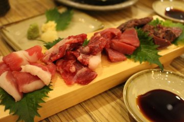 <p>A variety plate of horse meats. The meat on the right is cooked, but the others are mostly raw</p>