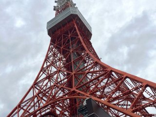 The bus stop for Tokyo Tower is located at the base of the tower.