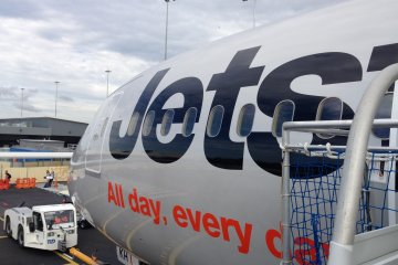 As Jetstar operates from low cost terminals in Tokyo and the Gold Coast, there is no air bridge service. Instead you need to climb some stairs to get to the aircraft.