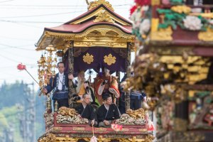 The floats roll their way through the streets of Yatsuo