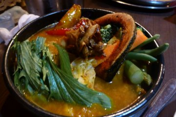 Vegetable soup curry, served with a bed of soft safron rice