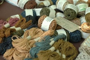 Yarn made from natural fibers and dyes make a colorful spread.