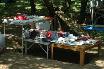<p>Sometimes, there are children&#39;s clothes given for free. In the background is a slide made from forest materials.&nbsp;</p>