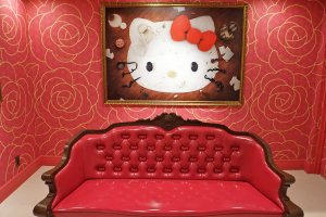 Inside the Lady Kitty House features this painting and fancy love seat.