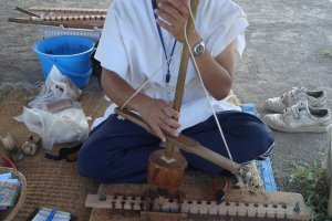 A volunteer demonstrates fire-make methods used by the Yayoi people