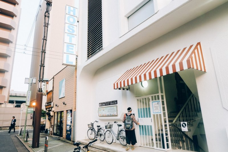 <p>The exterior of Nagoya Travellers. Spot the big signage of &quot;Hostel&quot; and usually there are lots of bicycles parked outside the building.</p>