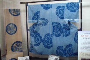 Kimono and kimono fabric dyed in Arimatsu featuring the family crests of the Tokugawa (left) and Oda (right) clans
