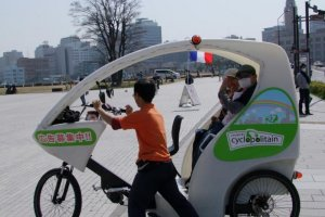 The uniqueCyclopolitain Taxi may be slow, but passengers can enjoy great views of Yokohama.