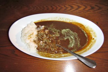 <p>A friend reported that this curry rice is actually spicy but not so much that one needs to reach for a glass of water</p>