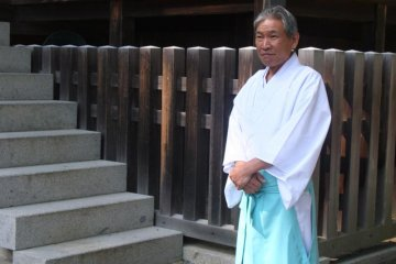 <p>A shinto priest within the grounds of Konpira-san</p>