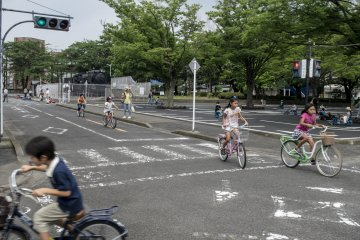 <p>Kids riding around the track complete with actual road signs and working traffic lights. Most of them follow the rules. Most.&nbsp;</p>