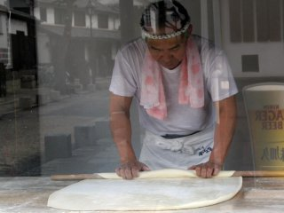 A local sweet maker prepares his pastry for the day
