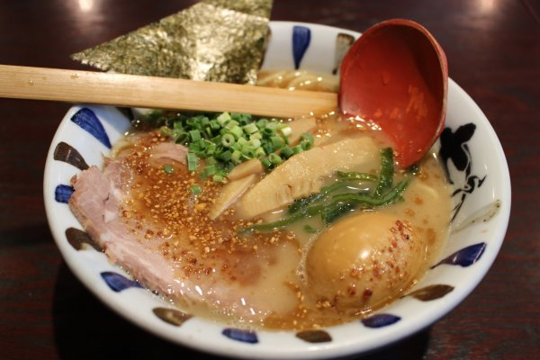 Iekei-style ramen. Nanashi/Baisen ramen topped with roasted garlic and sesamic.