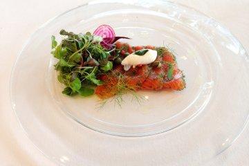 Marinated Sanuki Salmon with dill, Japanese pink pepper balls, lightly dressed micro leaf salad