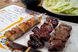 A chicken, beef, and pork skewer