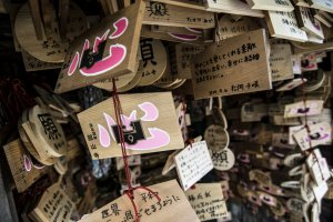 The shrine is literally covered with votive tablets praying for strong relationships and luck in love.