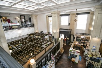 <p>The view from the second floor. While the architecture of the Bank is clearly distinct, the new tenants and their interesting shops make for a bizzare but very curious constrast with the existing infrastructure.</p>