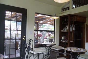 <p>Lovely and bright, but with air conditioning! You can see the outdoor seating area through the window.</p>