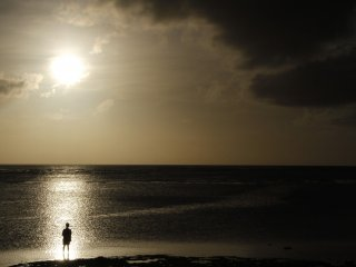 Watch the sunset from one of the many beaches in Okinawa.
