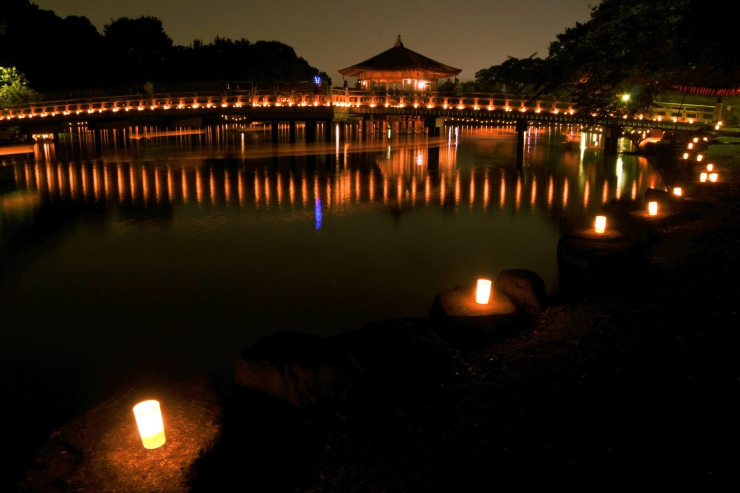 Lanterns from the Tokae and boats reflected in a pond in Nara Park