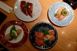 "Clockwise from top-left: katsu tataki, the ""Mmmm,"" inducing aburi shio negi salmon, salmon toro and kanpachi"