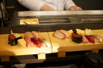 <p>A few pieces of sushi on display</p>