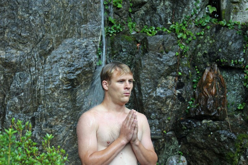 <p>Meditating under the waterfall mid-ceremony &nbsp;</p>