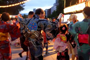 Three generation take part on Hokkai Bon Odori for children.