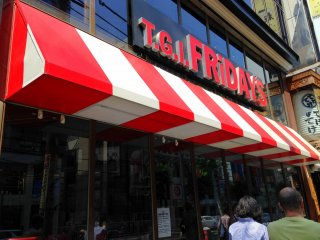 Who could not see the restaurant's huge name above the red-and-white shade awning?