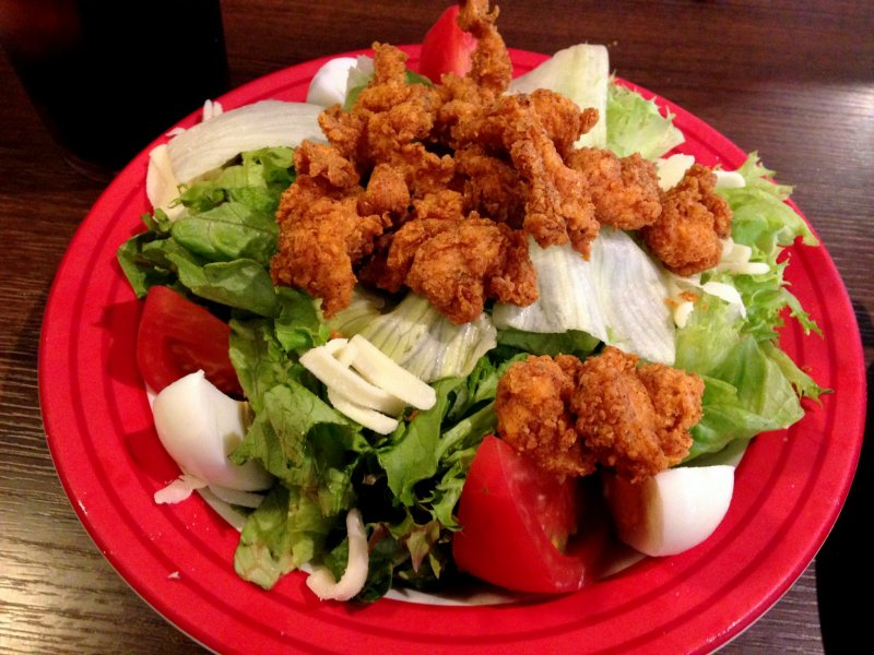 <p>Crispy fried chicken on veggies made a wonderful complement to the other dishes served.</p>