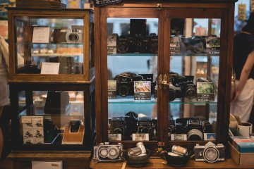 <p>Cabinet of perfect condition second hand cameras</p>