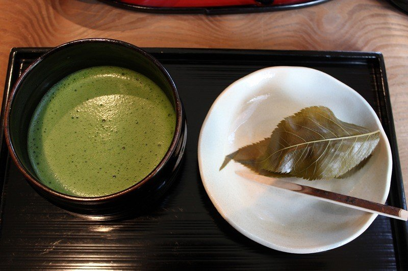 Matcha tea with the most popular Japanese sweet - Sakura mochi (a rice cake stuffed with bean paste and wrapped in a leaf)