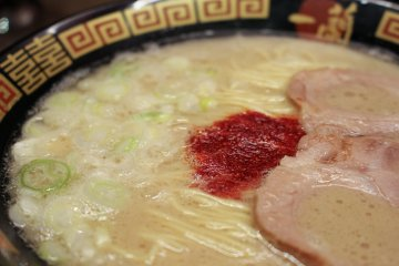 <p>Close-up of the char siu and spicy red sauce</p>