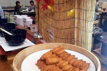 <p>A fall display behind the inarizushi (fried tofu skin stuffed with vinegar rice)</p>