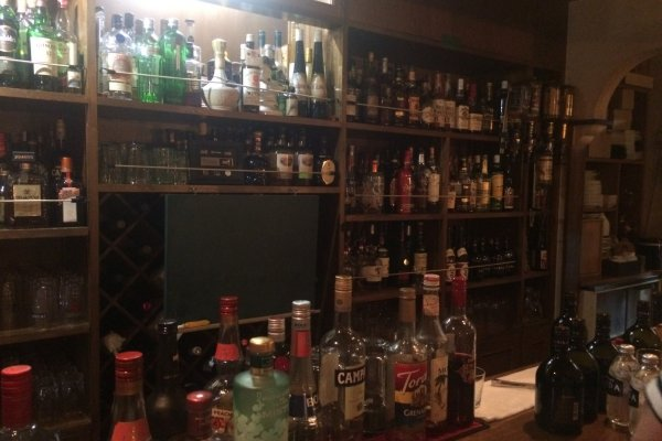 Only a portion of the drinks available behind the bar.