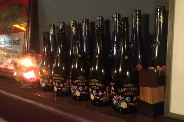 <p>Old bottles lined up for display.</p>