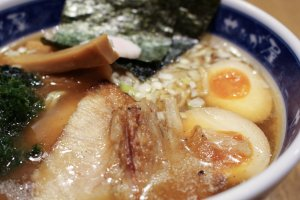 Sliced pork, soft-boiled egg and bamboo shoots all competing for your attention.