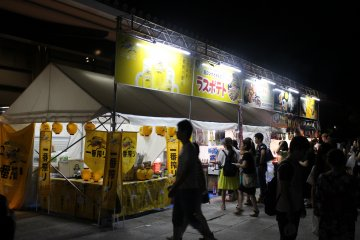 <p>Festival food and beer stalls were present outside the Kasugano International Forum Hall</p>